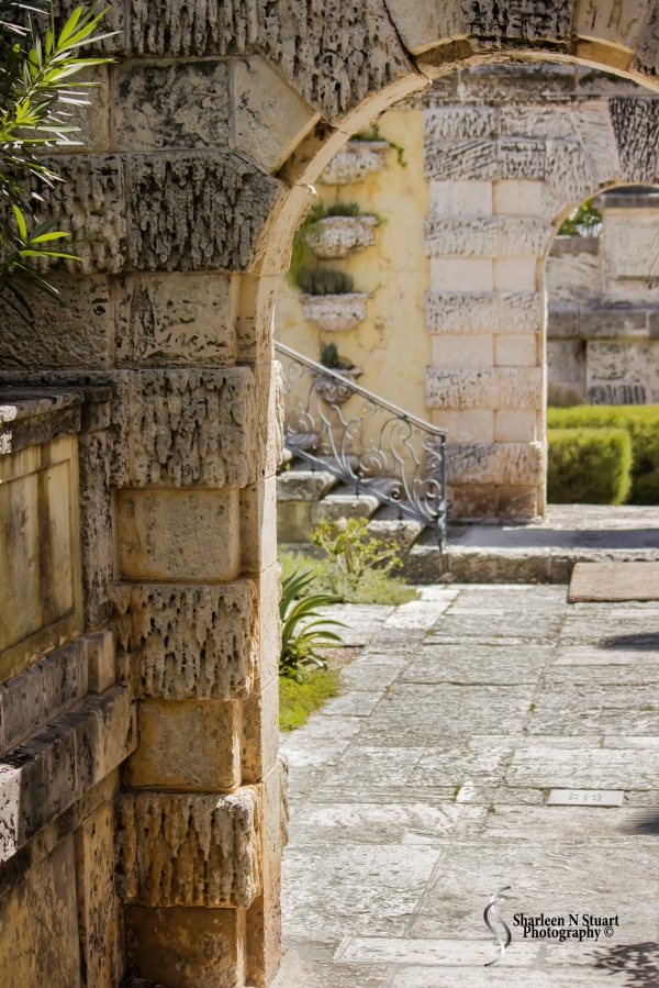 Archeways of stone and coral lead you you through walkways from sector to sector.