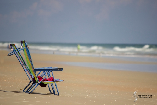 Two lonesome chairs on the beach
