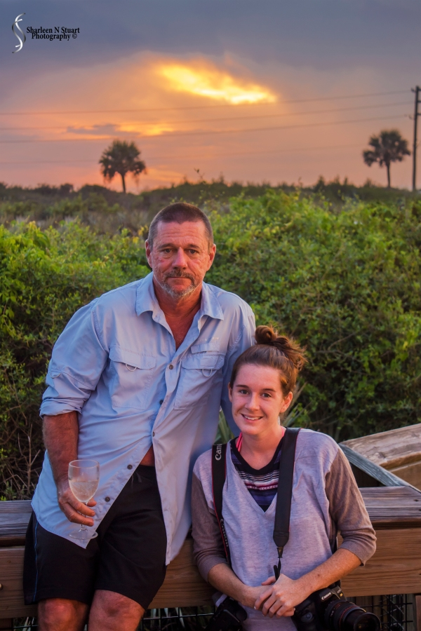 Richard and Amy enjoying the sunset - with a camera and a glass of wine