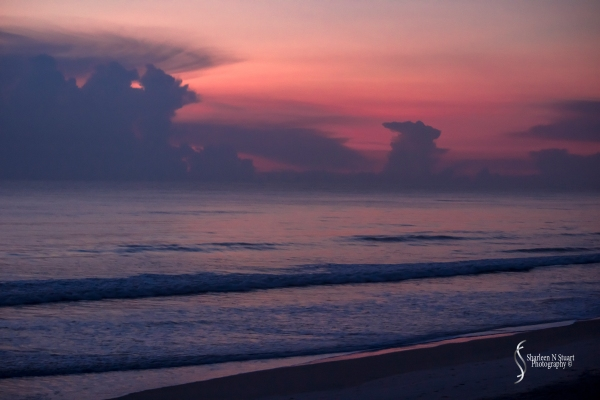 6:55am and it is still realtively dark out. I am on the beach alone and enjoying the solitude.