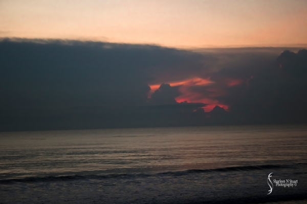 There was a small gap in the clouds where the red of the sunrise intensified. s