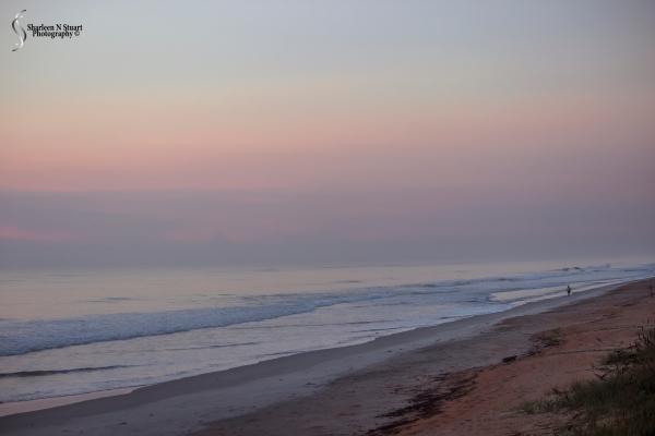 Sunrise stroll along the beach