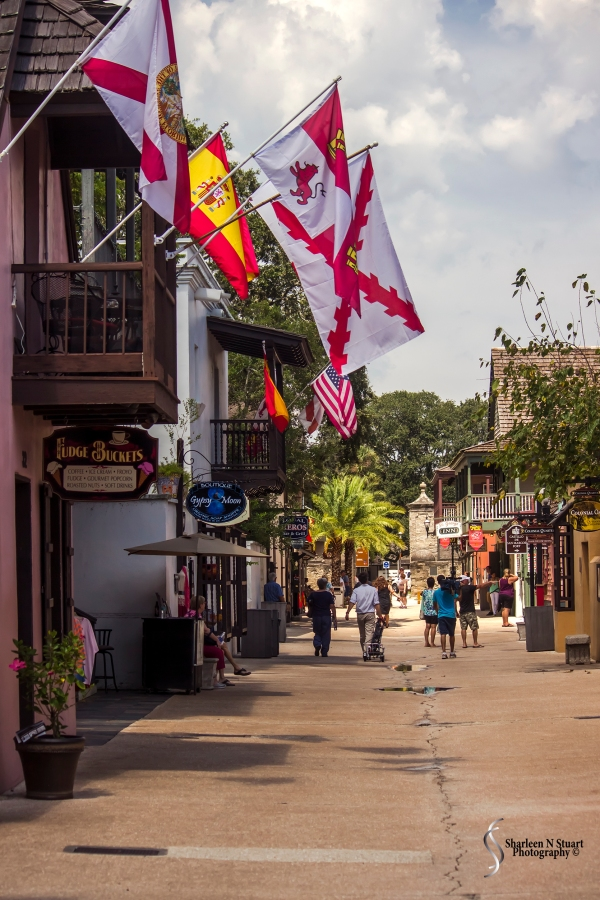 A walk through the Old City in St Augustine. Always a favorite past time of mine. This day followed a weekend of celebration the first landing in St Augustine. Flags decked the buildings, lamp posts were wrapped in decorative banners. The shopkeepers said the weekend had been hectic. So glad we came through on the Wednesday.