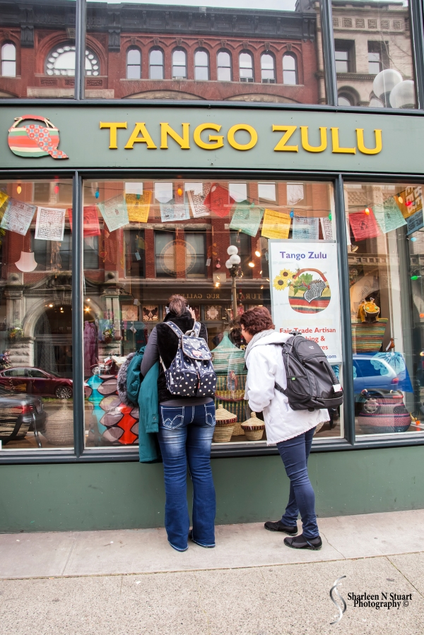 The two Africans peering into the Tango Zulu shop