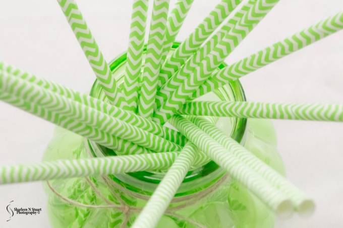 Green straws in a container