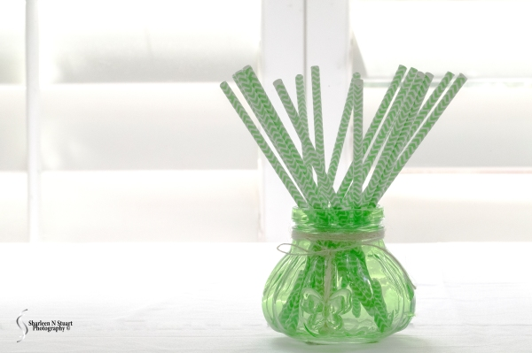 Green Vase and Straws